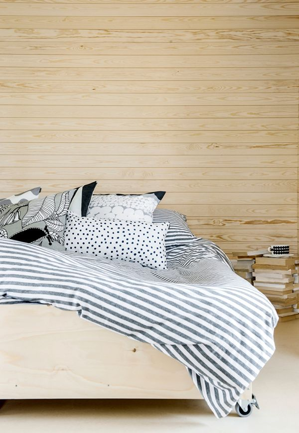 comfy cozy! love the light wood. stripe duvet feels a little too lazy day for me, but fun mixing of patterns
