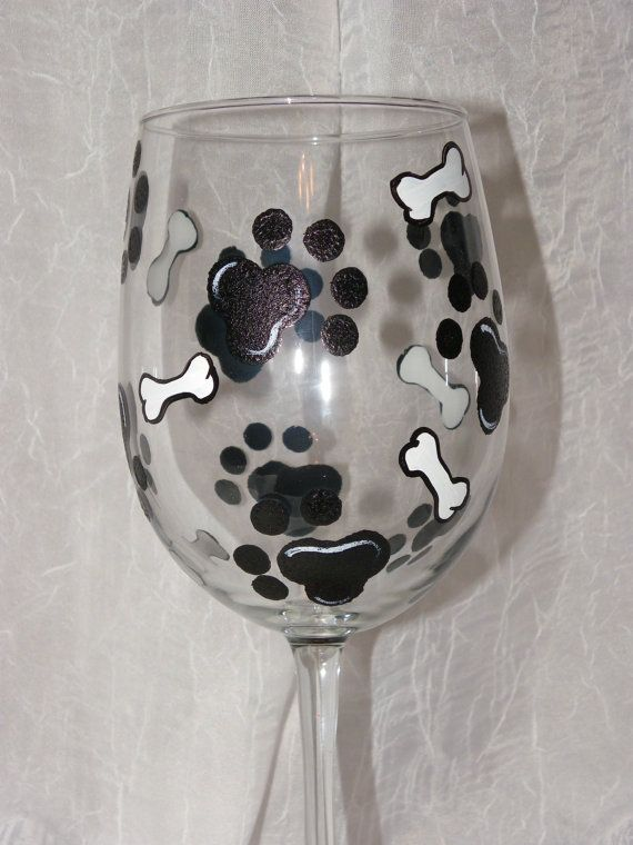 18 oz. white, high quality, hand painted wine glasses. This design features black dog paws and white dog bones. You can pick any color collar you