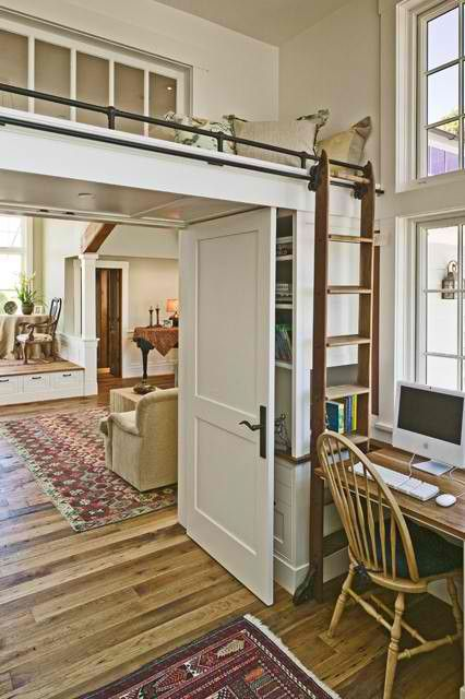 love the idea of putting a loft bed right above the doorway.....would really open up the rest of the room....