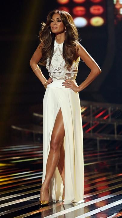 Nicole Scherzinger's X Factor fashion: Nicole looked stunning in this cream gown with a detailed bodice and thigh-high split. Copyright [Rex...