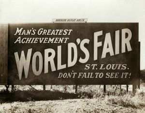 """""""Man's Greatest Achievement--Worlds Fair--St. Louis--Don't Fail to See It."""" Billboard at State and Washington Streets in Minneapolis, Minnesota advertising the 1904 World's Fair in St. Louis."""