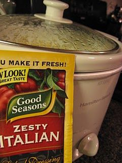 crock pot chicken in 5 ingredients - chicken, rice, cream cheese, cream of chicken, and italian seasoning.