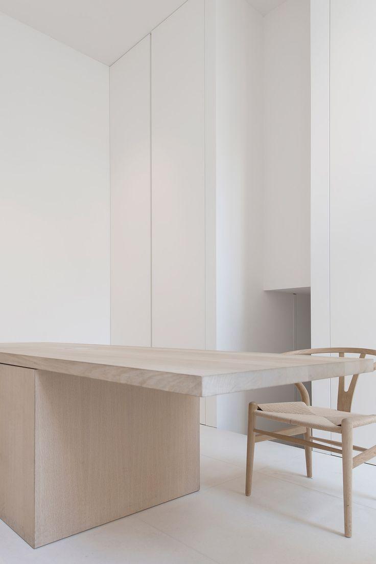 Koetsier - Van der Velden studio •     Interior executed by Nieuwkoop International. Bespoke interior. Minimalistic modern design. Interior details. White lacquer cabinet. Oak table.