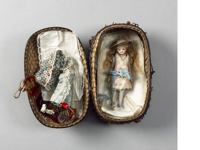 "Miniature 5"" All-bisque doll in basket, circa 1880"