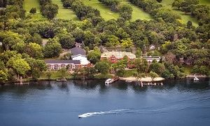 Groupon - Stay at Heidel House Resort & Spa in Green Lake, WI, with Dates into October in Green Lake, WI. Groupon deal price: $84