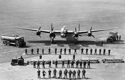 A graphic line-up of all the personnel required to keep one Avro Lancaster of RAF Bomber Command flying on operations, taken at Scampton, Li...