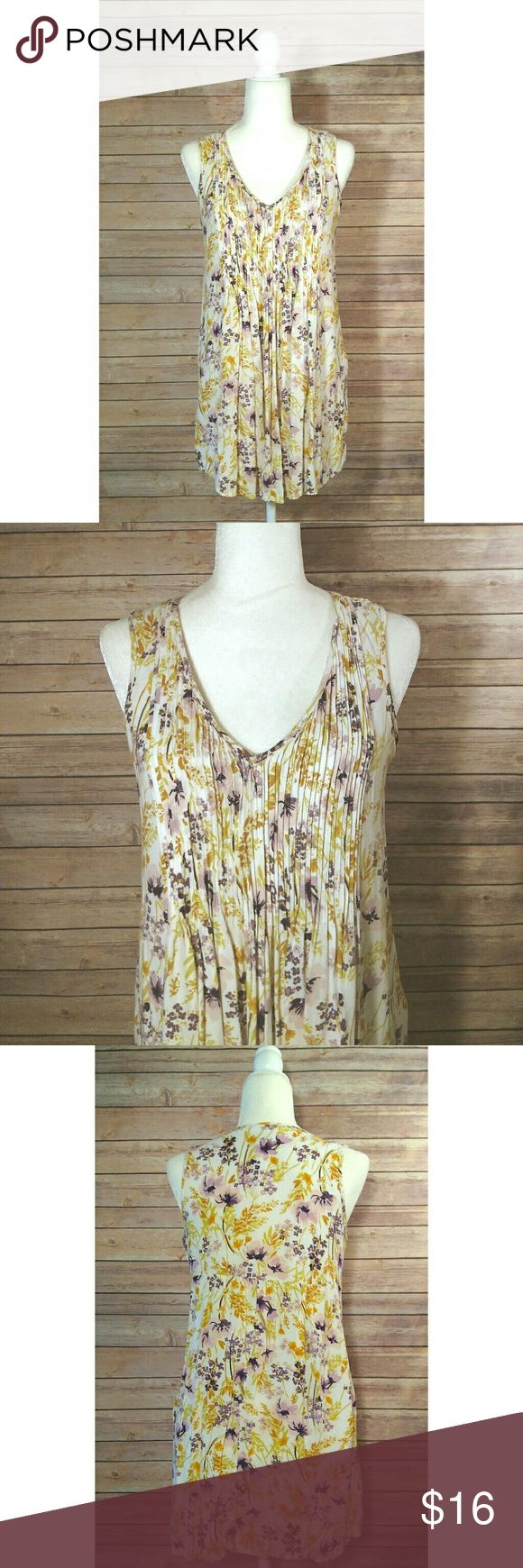 Old Navy floral pleated v-neck sleeveless tunic Old Navy tunic top in a cream color with a yellow and lavander floral print.  It has a v-neck and the upper part of the front is pleated.  It is a sleeveless tunic top.  It is a two layer tunic, the floral print fabric is a light gauzy fabric and the lining is a solid cream color fabric.  It has a zipper on the side.  It could also be worn as a short dress.   Pet free smoke free home. Old Navy Tops Tunics