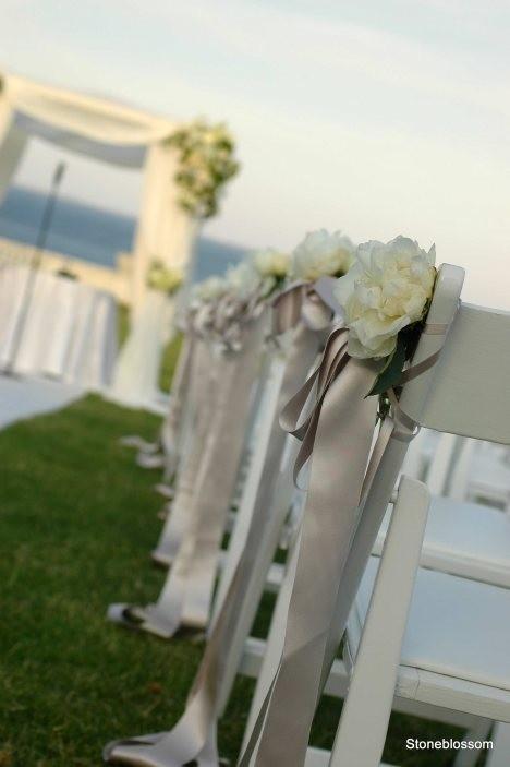 Wedding isle chair decorations.