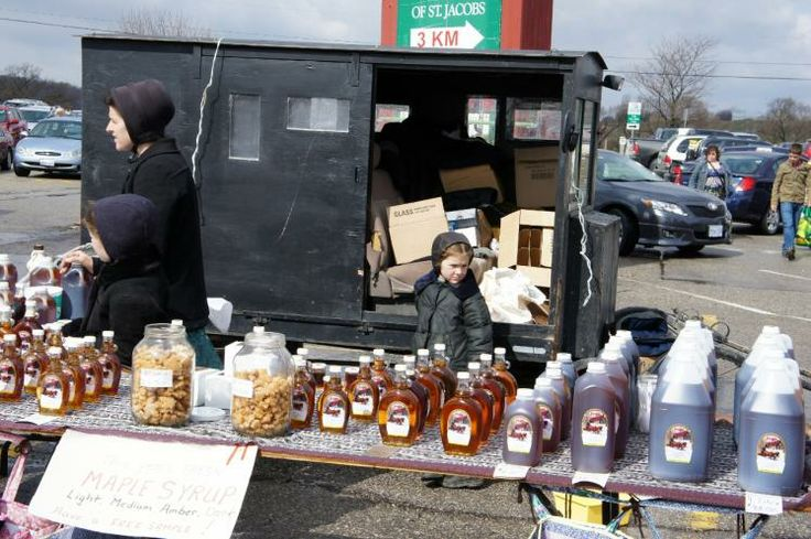 Mennonites selling maple syrup at St. Jacobs Farmers Market