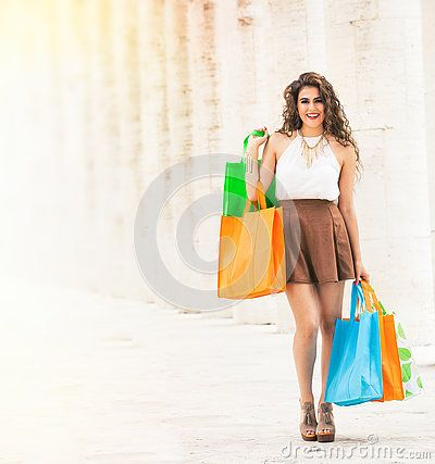 Shopaholic. Shopping love. Beautiful happy woman with bags.