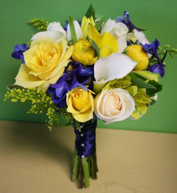 Blue and yellow wedding flowers: imagine yellow ranunculus, cream narcissus & blue iris with fern foliage