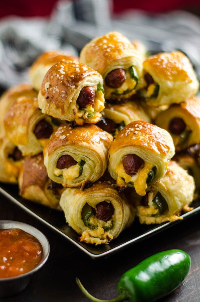 Jalapeno Popper Pigs in a Blanket. These spicy, cheesy appetizers are perfect for your next party or game day!