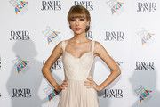 Taylor Swift dazzled Thursday in Sydney at the ARIA Awards. The country star wore a sexy white gown with sheer side panels and her hair pulled back in an angelic updo. The look was a tad wedding-esq...