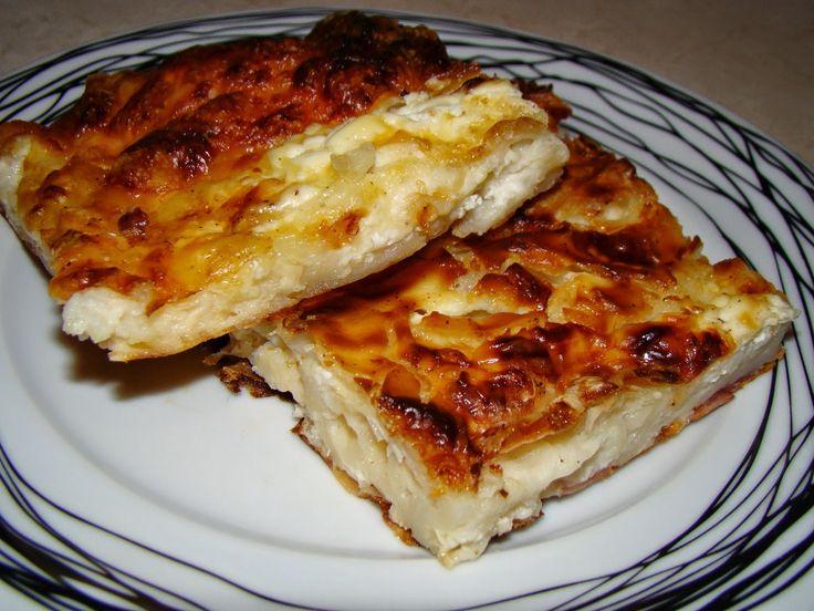 Tυρόπιτα express φανταστική!  Υλικά: 1 πακέτο φύλλο κρούστας 6 αυγά 400γρ κρέμα γάλακτος 500-600γρ τυριά τριμμένα 700ml γάλα Φρεσκοτριμμένο πιπέρι Λίγο σκόρδο σκόνη(προαιρετικά) 10 φέτες ζαμπον ψιλοκομμένο (προαιρετικά) Εκτέλεση: Σε ένα μεγάλο ταψί σπάμε τα αυγά,ρίχνουμε τα 500ml γάλα,τα 200ml κρέμα γάλακτος και τα χτυπάμε ελαφρά με ένα πιρούνι ή σύρμα Προσθέτουμε τα τυριά(κρατάμε …