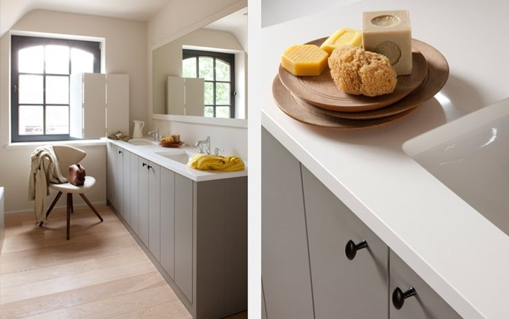 Bathroom. Nice bright space. Love the wood and grey cupboard combination.