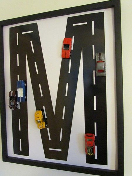 Kind of a cool idea for a boys room. use the letter of their first name to make the road. Then glue hotwheels on and place in a shadow box.