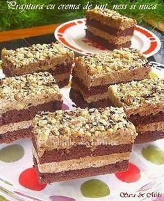 Prajitura de cacao cu crema de unt, ness si nuca cu o combinatie de ingrediente care dau un gust special.