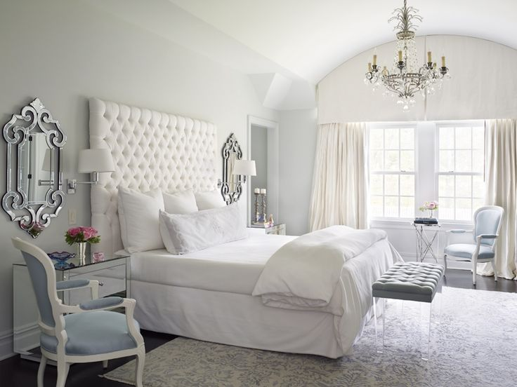 Beautiful bedroom designed in cool tones of icy silver and light blue.
