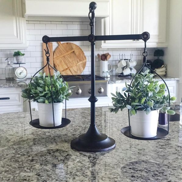 """This unique decor item was recently featured on a popular decorating show. Place one of our Baby Grass candle rings inside for a simple pop of color. Decorative Iron Scale. 23"""" wide x 23 ¼"""" tall."""