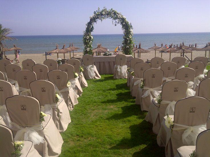 Beachside blessing ceremony set up for weddings in Spain. Vincci Estrella del Mar beach club in Marbella. Get married in Spain.