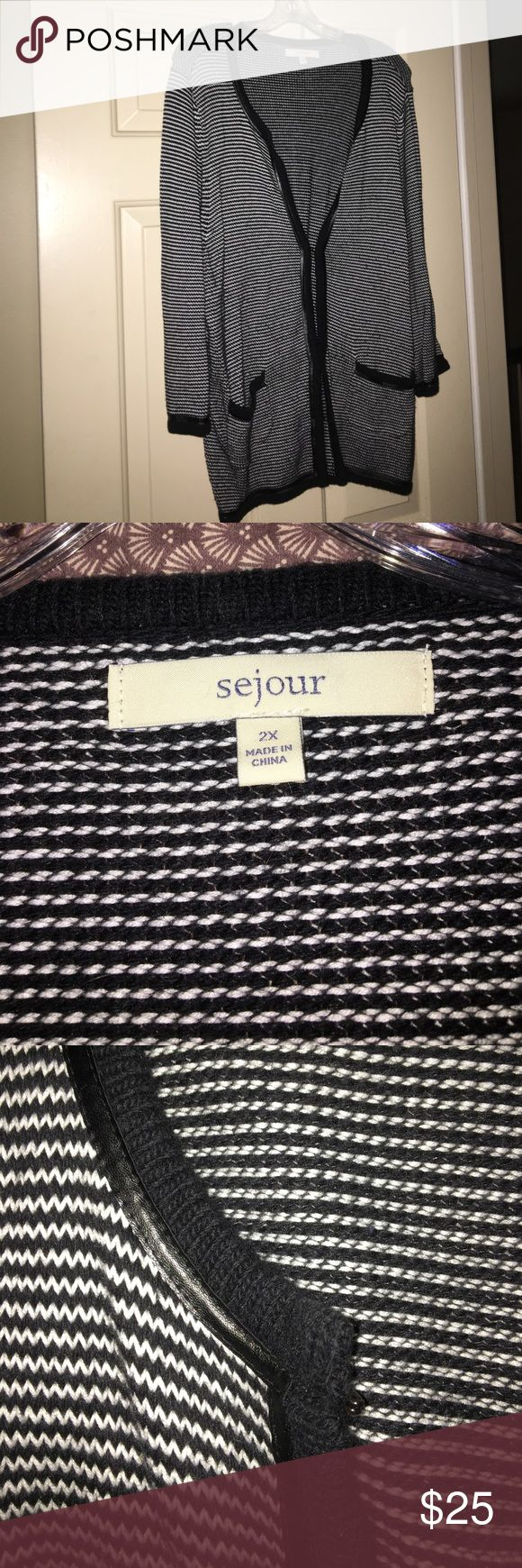 Sejour black and white cardigan size 2X This black and white cardigan is quite versatile as an extra layer of warmth or as a fashion piece.  Hook and eye closures up the front to make this a perfect cardigan. Sejour Sweaters Cardigans