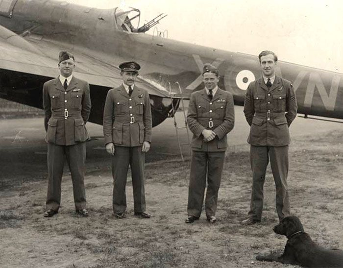 "Many a young man who sought comfort and friendship with a squadron dog would go on to greatness including Air Chief Marshal Sir Augustus Walker GCB CBE DSO DFC AFC. Here we see ""Sir Gus"", as he was known, with his crew of No 50 Squadron in front of a Handley Page Hampden, with Fifty Gus' dog, RAF Lindholme 5 November 1940. Photo: Courtesy of Yorkshire Air Museum"