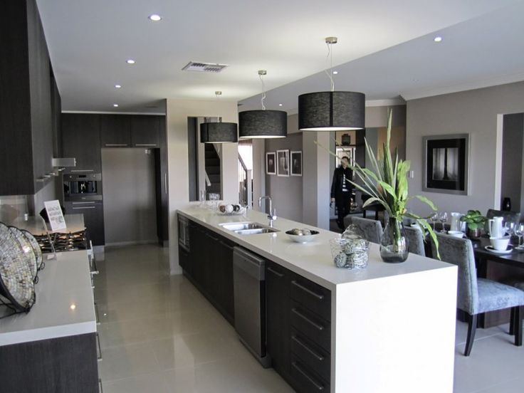 Interior, Awesome Kitchen Interior Design With Long White Kitchen Island With Wood Storage Cabinets L Shaped Black Laminate Wood Kitchen Cabinet Black Round Shade Pendant Lamps White Tile Flooring Built In Microwave Dining Area: Perfect and Ideal Kitchen Interior Design Ideas