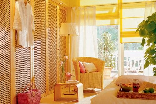 Lattice front closet doors give this bedroom and light and airy feel