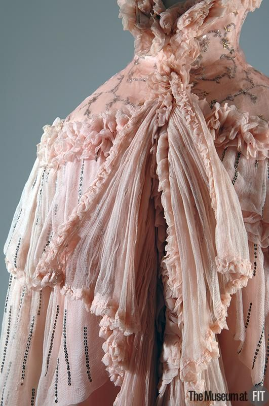Evening cape Brand: Paquin 1891 - 1956 Pink silk chiffon and metal sequins Date: 1897