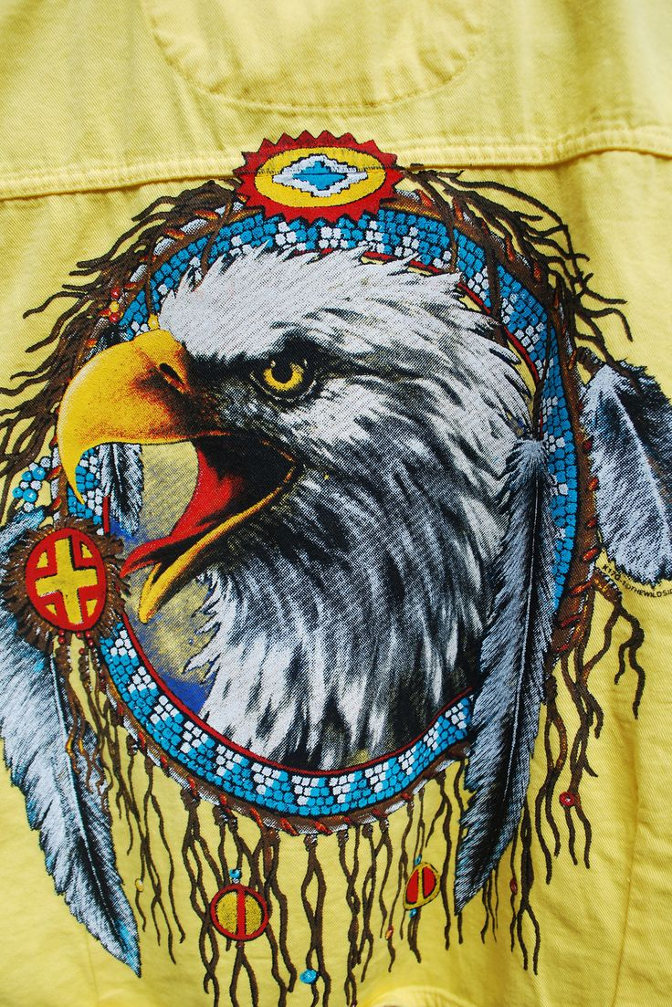 This bright, tie up shell from River Run commemorates the Sturgis Motorcycle Rally in South Dakota. Raw edged drop sleeves, double breast pockets and button up design in front. Badass eagle graphic with a southwestern frame on back.