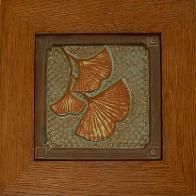 Framed Gingko tile in green & copper glaze. framed by Family Woodworks LLC
