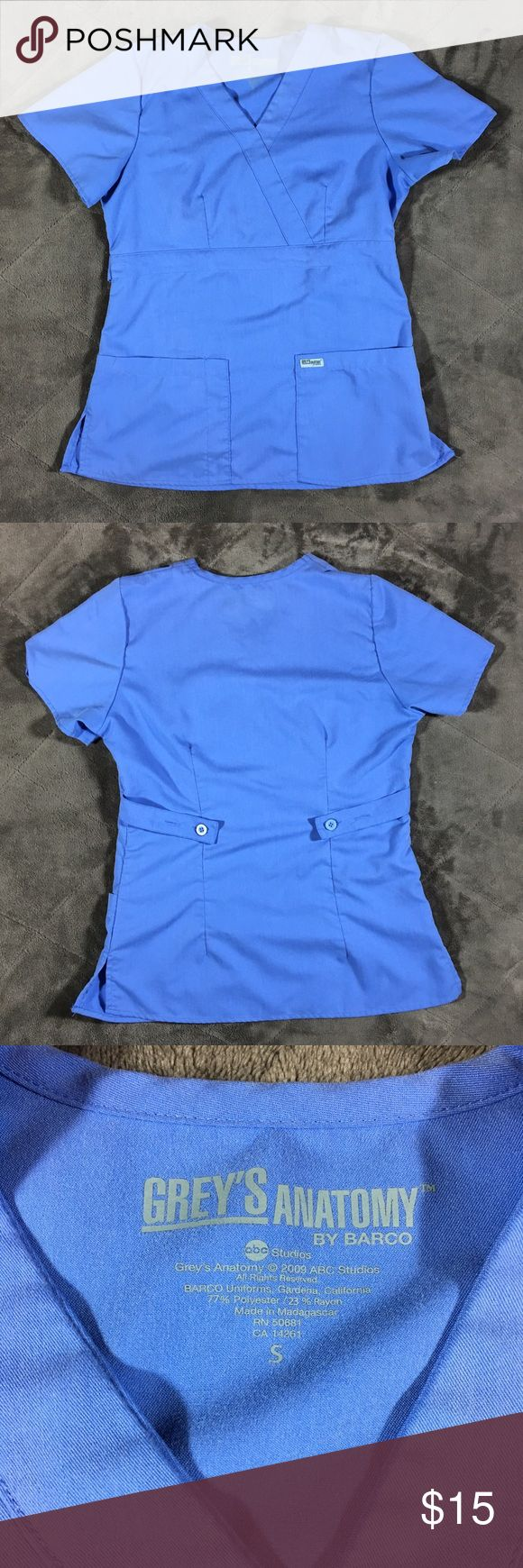 Grey's Anatomy Scrub Top Light Blue Mock Wrap Grey's Anatomy Mock Wrap 3-Pocket scrub top in Serenity Blue (light blue). Size small (fits size 2-4 per website). Very good pre-owned condition. Has one tiny snag plus small amount of pilling on back right side, as pictured.  No trades, no modeling.  Thanks for looking, and happy Poshing!!  77% polyester, 23% rayon Grey's Anatomy Other