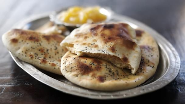Anjum Anand's simple naan breads, flavoured with garlic and fresh coriander, are quick and easy to make.