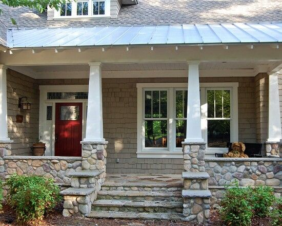 Love the stones and the tin roof over the porch!