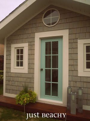 The exterior is clad in cedar shakes from Lowe's stained Cape Cod grey by Behr