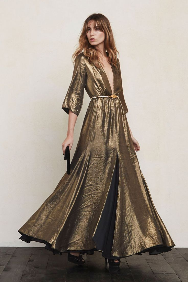 The Hall Dress really needs no introduction. Just look at her. This is a long sweeping gown with a plunging V neckline, sheer cropped sleeves and a front slit. The waist is fitted but the skirt allows plenty of room for dancing or just dramatically entering and exiting rooms.  https://www.thereformation.com/products/hall-dress-goldmine?utm_source=pinterest&utm_medium=organic&utm_campaign=PinterestOwnedPins