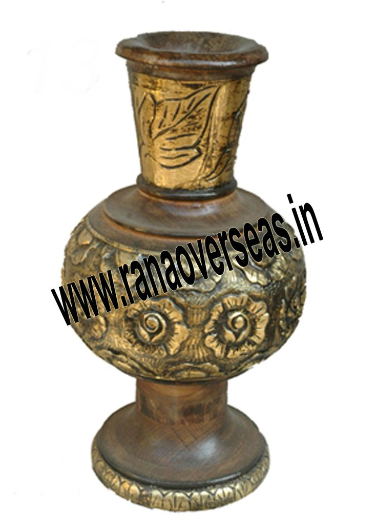 These Flower vases chiseled out of variety of materials in varied shapes are extremely eye-catching with their compelling beauty. The Wooden flower pot base is made heavy to provide support to its body. Our flower pots have gained immense popularity worldwide. Wooden Flower pots are available in a variety of sizes, designs and styles. The Wooden flower pots are sure to look new for years to come.