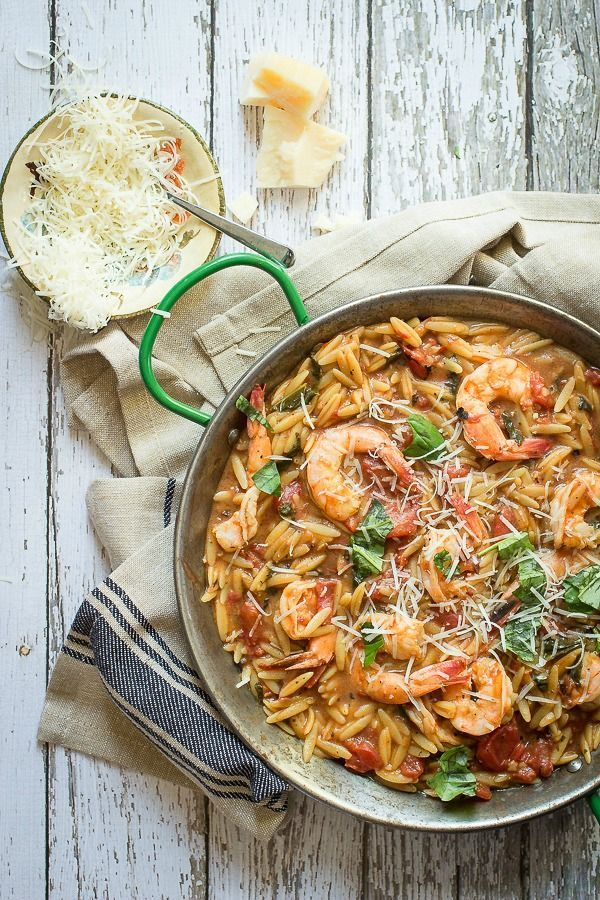 Giant shrimp cooked in a tomato and chicken broth and served with orzo pasta