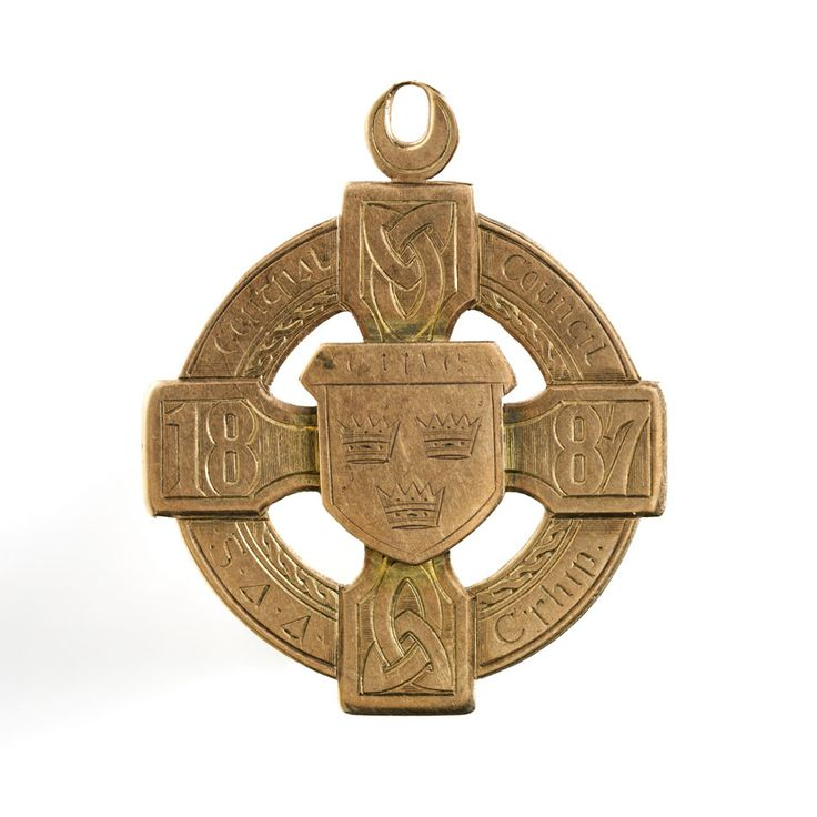 """88. GAA Medal. This gold medal was presented to a Limerick player, P.J. Corbett, after the first all-Ireland Gaelic football championship in 1887. Three years earlier, on November 1st 1884, at Hayes's Hotel in Thurles, Michael Cusack convened the first meeting of the """"Gaelic Athletic Association for the Preservation and Cultivation of National Pastimes""""."""
