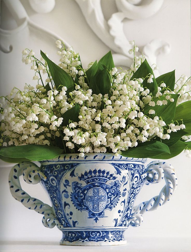 lily of the valley in blue and white cache pot
