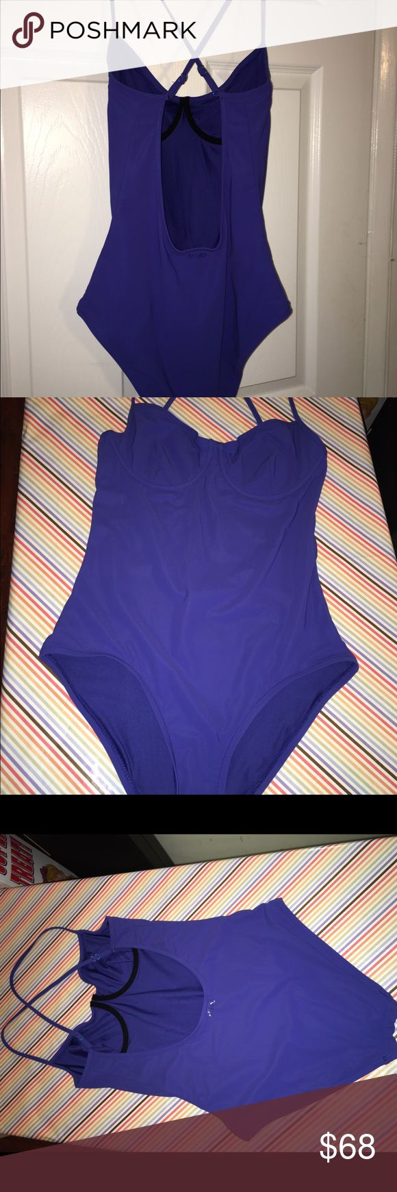 """Marc by Marc Jacobs Underwire One Piece Bikini Gorgeous royal purple sexy underwire one Piece Bikini with elegant neckline, adjustable thin criss-cross straps and open back. Worn once! Excellent barely worn condition with no damage, fading, stains, odors. Guaranteed clean & authentic. No wear to logo or tags. Measurements (unstretched): chest: 30"""" length: 28"""" waist: 24"""" hips: 30"""" leg opening: 10""""flat 20""""around. Marc by Marc Jacobs Swim One Pieces"""