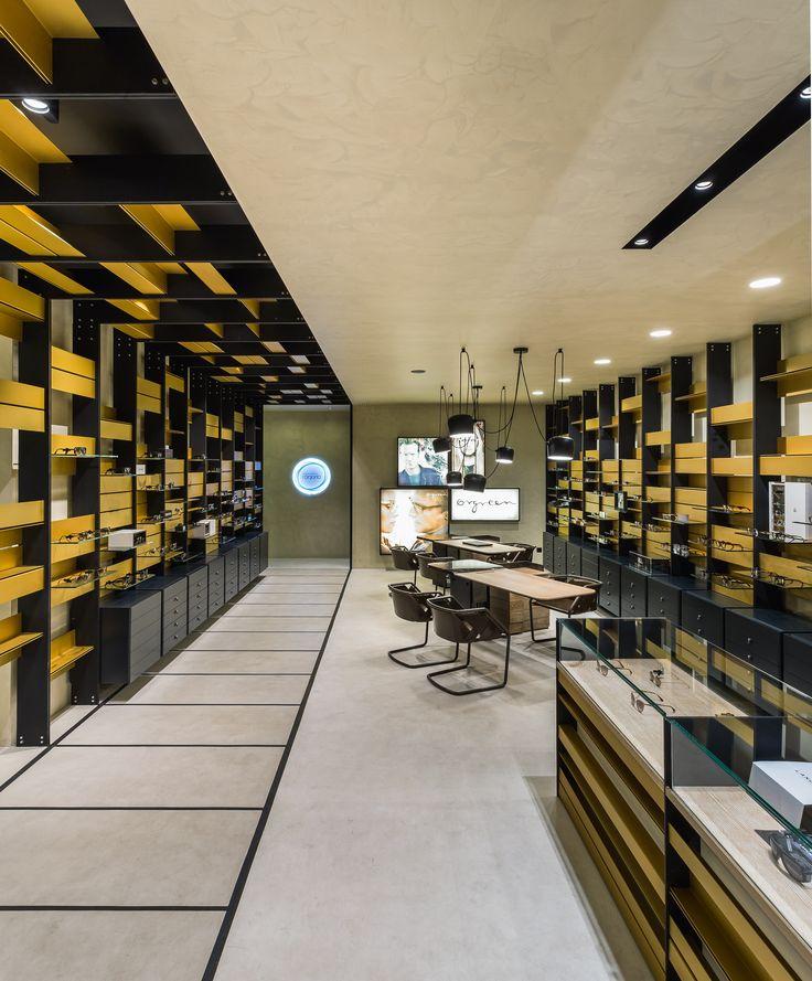XYZ Arquitectos Associados - Óptica Médica Rogério - Matosinhos - Portugal - interior design - optical store - Strip chair Henge - Aim pendant light Flos