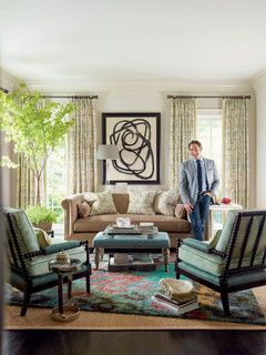need an area rug art curtians accent chairs living room featuring thom filicia fabrics
