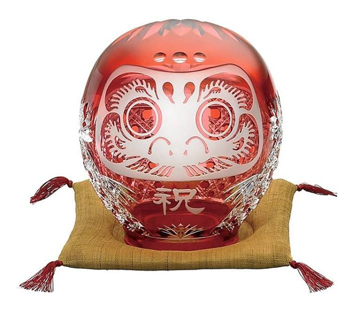Edo kiriko Daruma (江戸切子 だるま) as good-luck charm ~ a Japanese colored glass craft known for its unique engraved patterns, made by Kagami Crystal Co., Ltd., based in Ibaraki Prefecure. Kiriko (切子, cut glass) is a Japanese traditional artistic glass handicraft. There are two main regions producing Kiriko, the region of Tokyo producing the famous Edo Kiriko and the region of Satsuma, which is famous for its wide choice of colors