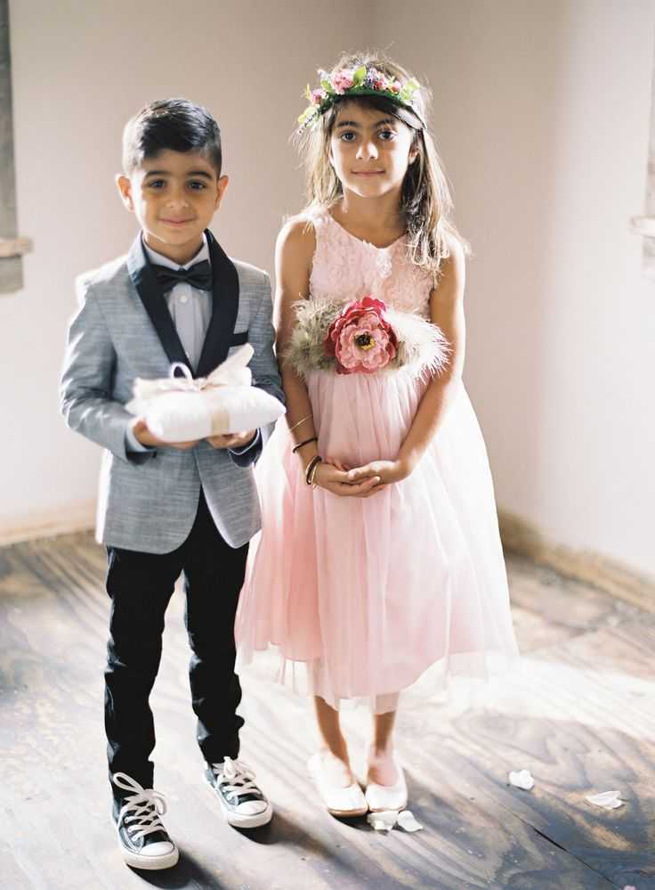 Too Cute! Ring Bearer & Flower Girl!! See the wedding here: http://www.StyleMePretty.com/2014/03/21/hilltop-al-fresco-wedding-in-malibu-california/ Photography: Kurt Boomer - kurtboomerphoto.com on #SMP