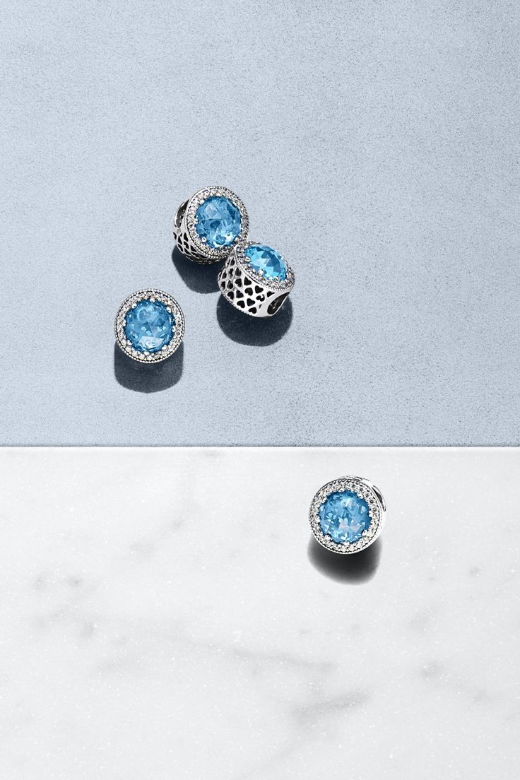 With its innovative shape and small, sparkling stones that frame a radiant sky blue crystal with small decorative hearts visible beneath, this dazzling charm has a truly lavish expression. Combine it with the matching ring for a stunning set fit for even the most glamorous event. #PANDORA #PANDORAcharm