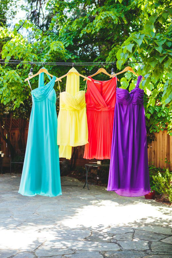 bright bridesmaid dresses // photo by The Goodness // View more: http://ruffledblog.com/colorful-foresthill-wedding/
