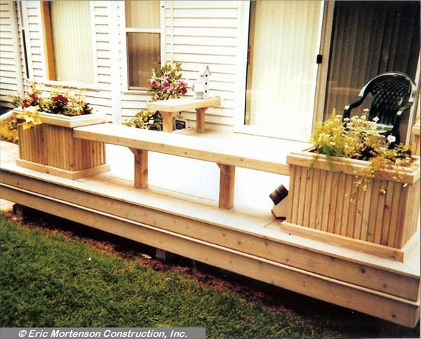 Simple flower boxes attached by a bench great idea for Flower bench ideas
