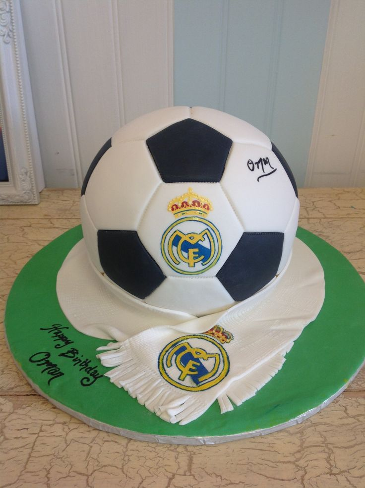 Real Madrid soccer ball cake with hand painted scarf detail.