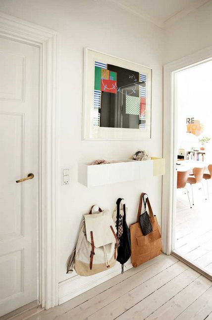 Love the hooks for bags idea. Even more so that it's at a low area, uses up the space under an eye-level shelf or artwork!